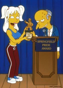 Die Simpsons - Britney Spears (l.) überreicht Mr. Burns (r.) einen Ehrenpreis...