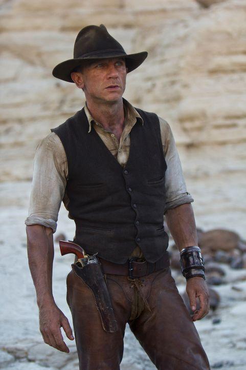 Als Jake Lonergan (Daniel Craig) mitten in der Wüste Arizonas aufwacht, hat der Cowboy sein gesamtes Erinnerungsvermögen verloren. Erst nach und nac... - Bildquelle: (2011) DREAMWORKS II DISTRIBUTION CO., LLC and UNIVERSAL STUDIOS.