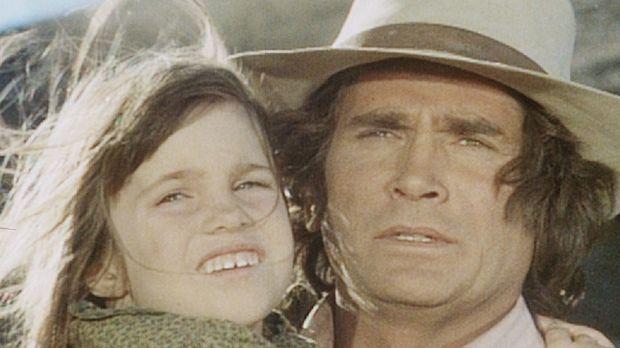 Charles (Michael Landon, r.) muss seine kleine Tochter Carrie (Lindsay Sidney...