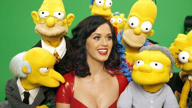 Katy Perry (M.) sorgt für gute Laune bei den Simpsons und ihren Freunden. © u...