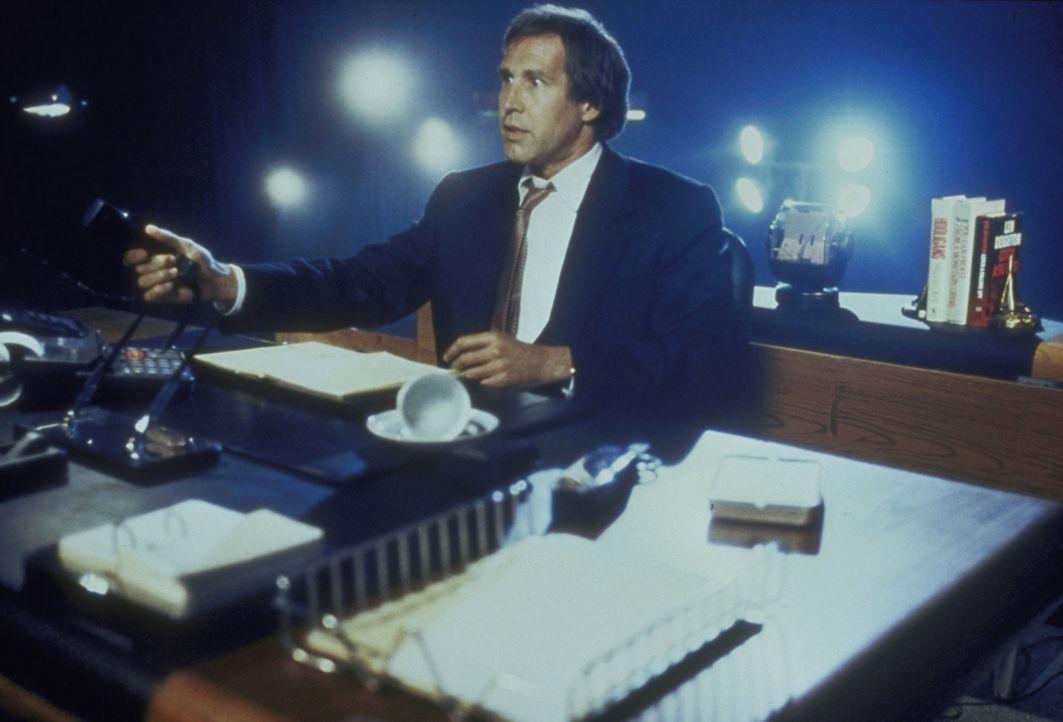 Lockeres Leben: Finanzspezialist Nick Halloway (Chevy Chase) geht erfolgreich den Weg des geringsten Widerstands. - Bildquelle: Warner Bros.
