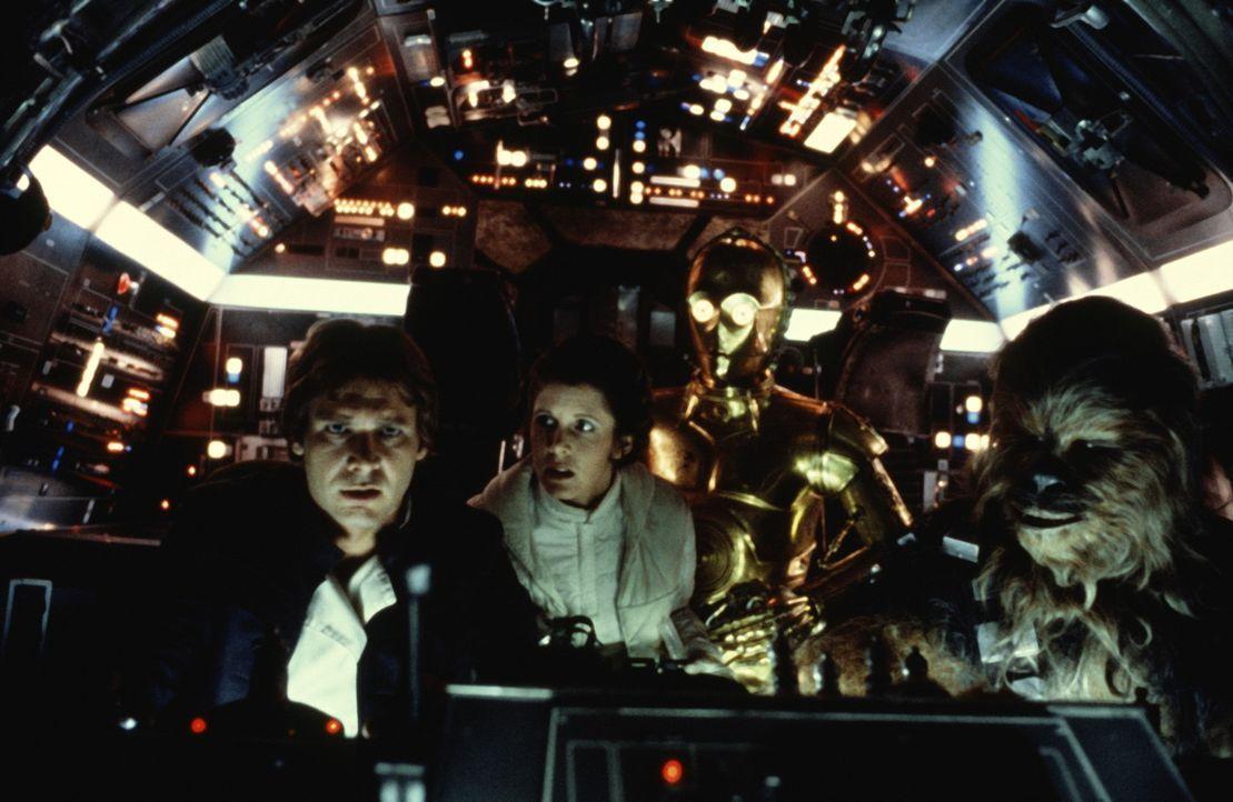 Auf der Flucht vor der imperialen Flotte: Chewbacca (Peter Mayhew, r.), C-3PO (Anthony Daniels, 2.v.r.), Leia (Carrie Fisher, 2.v.l.) und Luke Skywa... - Bildquelle: Lucasfilm LTD. & TM. All Rights Reserved.