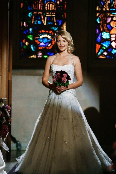 Nach und nach stellt sich heraus, dass Derek und Meredith ihre Hochzeit verschoben haben - stattdessen sollen sich Alex und Izzie (Katherine Heigl)... - Bildquelle: Touchstone Television