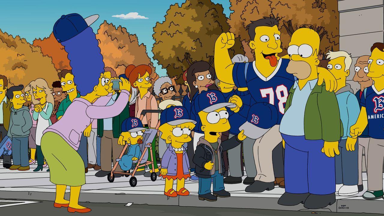 Dass seine Familie(v.l.n.r.) Marge, Maggie, Lisa und Bart wirklich die Springfield Rivalen Boston Americans anfeuert, setzt Homer (r.) unter Schock.... - Bildquelle: 2016-2017 Fox and its related entities. All rights reserved.