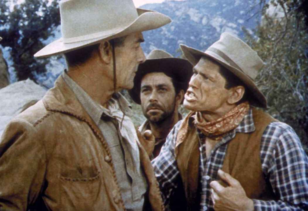 Noch macht der Postkutschen-Begleitposten Larry Delong (Randolph Scott) Witze, doch schon bald ist ihm nicht mehr zum Scherzen zumute ... - Bildquelle: Warner Bros.