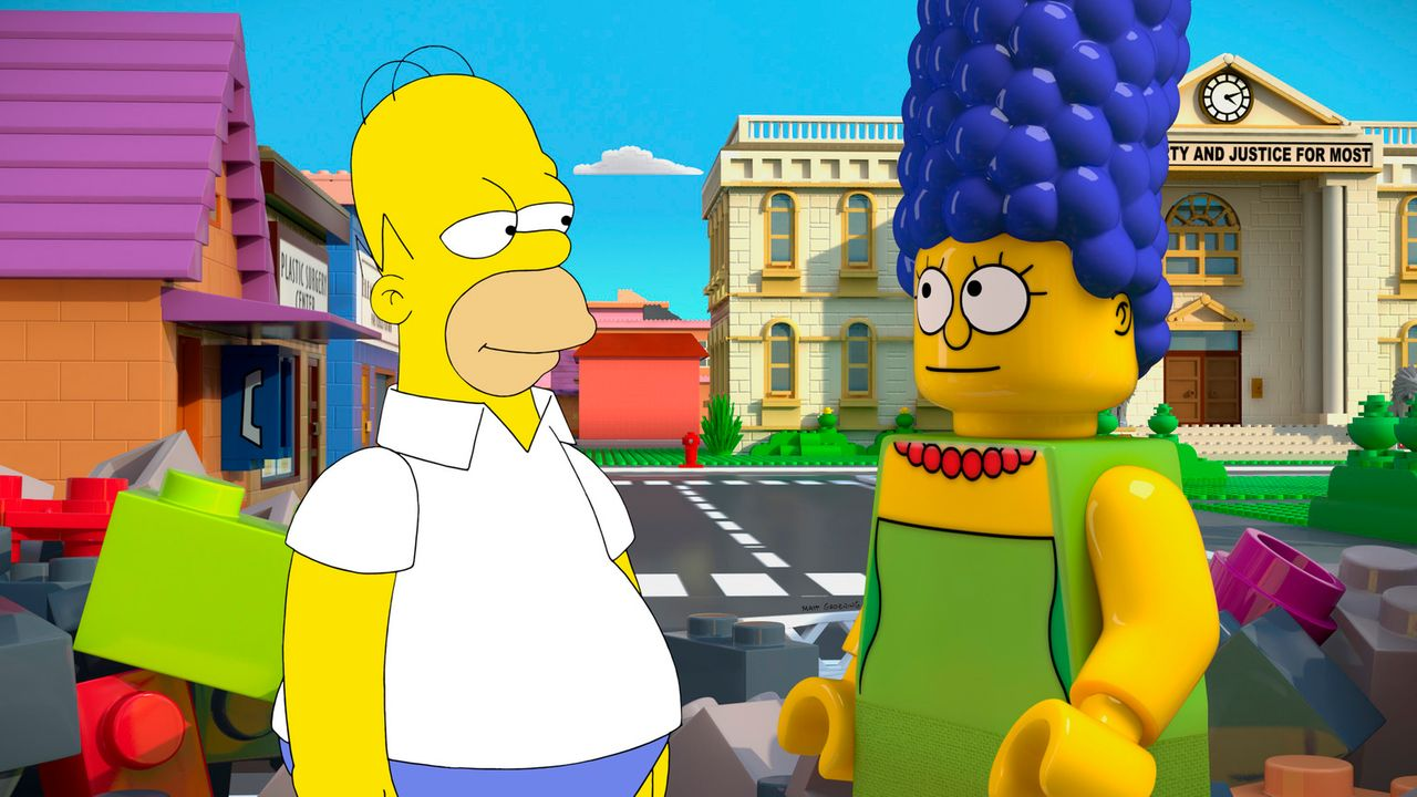 Ein Homer (l.) aus Fleisch und Blut trifft auf eine Marge (r.) als Legofigur - ob das gutgehen kann? - Bildquelle: 2013 Twentieth Century Fox Film Corporation. All rights reserved.