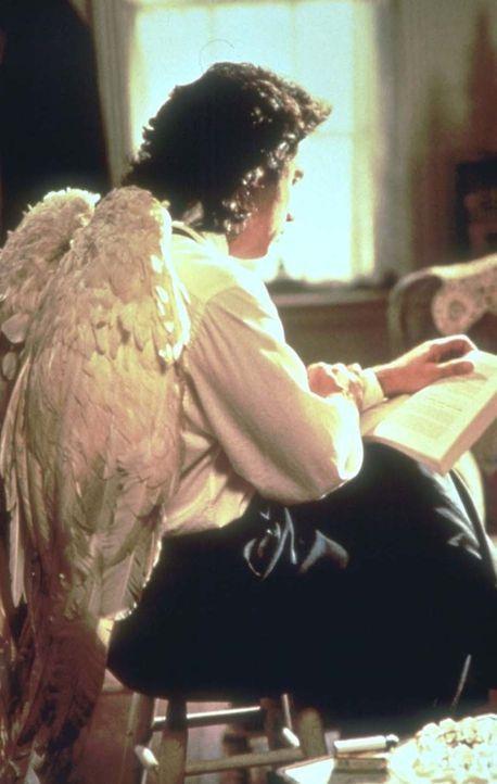 Erzengel Michael (John Travolta) - keineswegs blond, keusch und in weißem Gewand - ist in himmlischer Mission unterwegs ... - Bildquelle: Warner Brothers