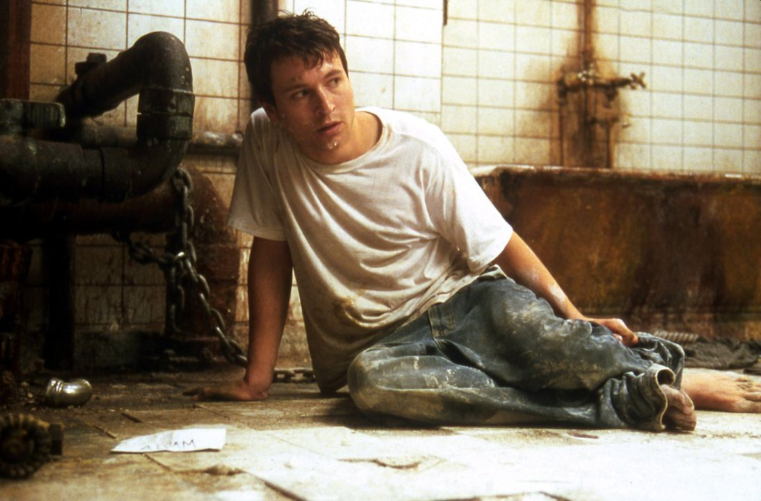 In der Hand eines kolossalen Psychopathen beginnt für Adam (Leigh Whannell) ein gnadenloser Wettlauf um Leben und Tod ... - Bildquelle: Twisted Pictures