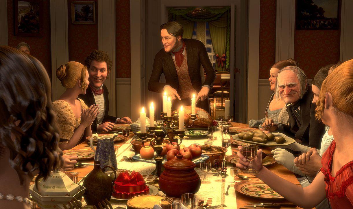 Nach alldem was Ebenezer Scrooge (Jim Carrey, 3.v.r.) erlebt hat - kann er doch noch ein glückliches Weihnachtsfest mit seinem Neffen Fred (Colin F... - Bildquelle: Walt Disney Pictures/Imagemovers Digital, LLC.