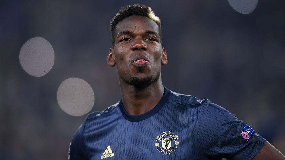 Paul Pogba flog mit Fans zurück nach Manchester - Bildquelle: Getty Images