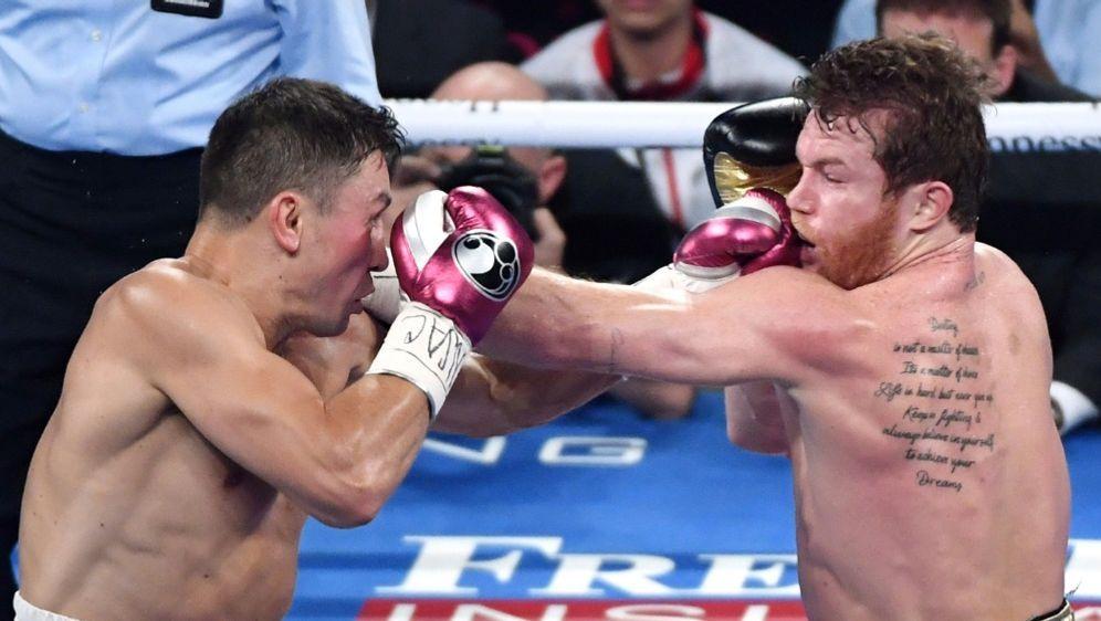 Golowkin (l.) muss sich Alvarez geschlagen geben - Bildquelle: AFPGETTY SIDEthan Miller