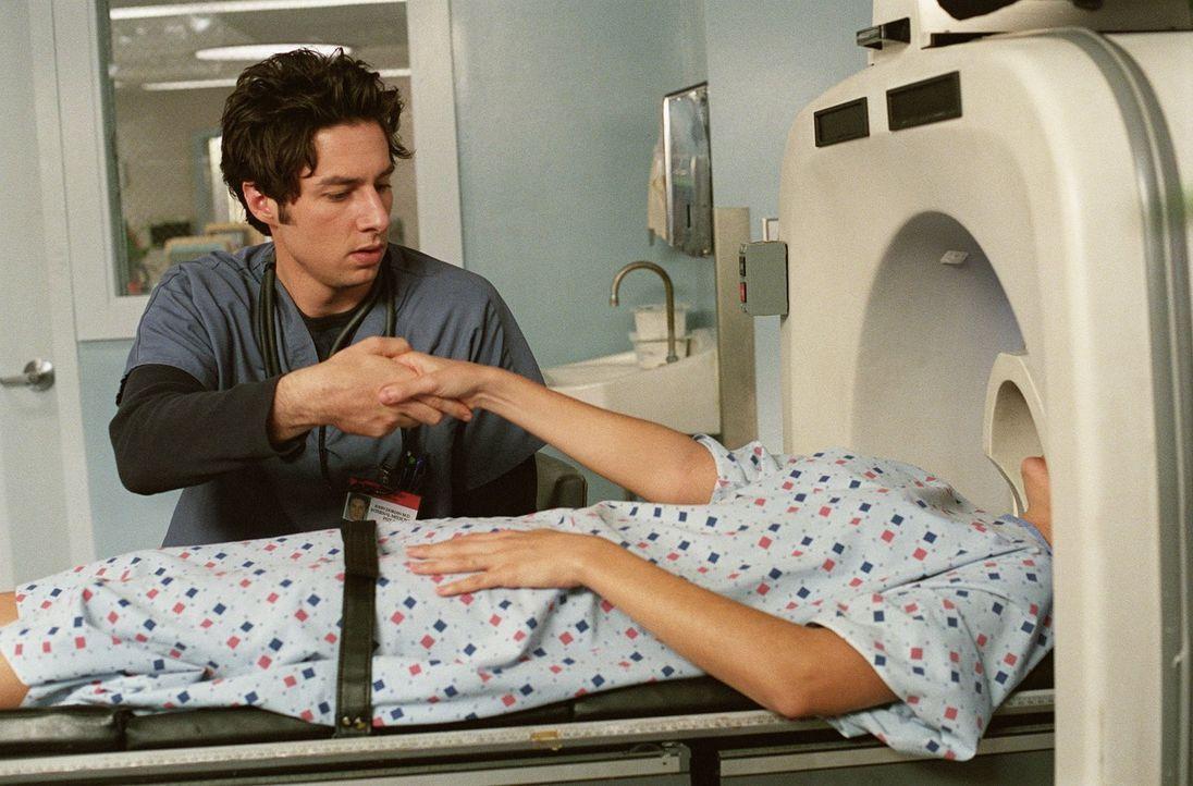 Obwohl J.D. (Zach Braff, l.) die Frau im Kernspin-Tomographie-Gerät nicht kennt, hat er sich in sie verliebt ... - Bildquelle: Touchstone Television