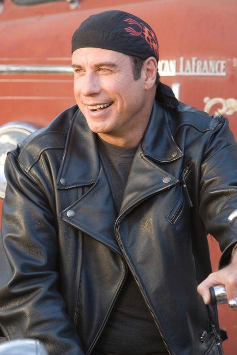 Vom perfekten Spießer, zum Möchtegern Biker: Woody (John Travolta) ... - Bildquelle: Touchstone Pictures.  All rights reserved