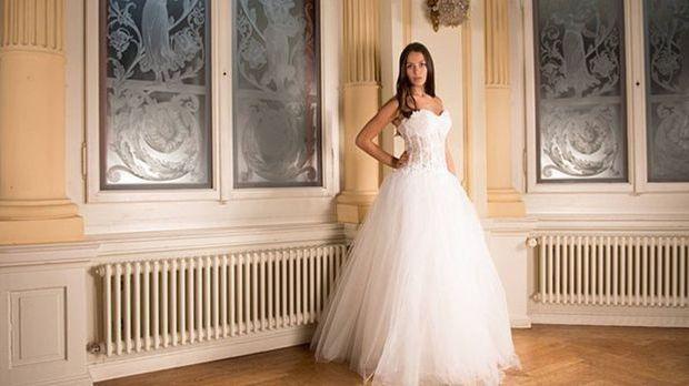 Bei einer sportlichen Braut darf das Brautkleid unten rum schon mal etwas vol...