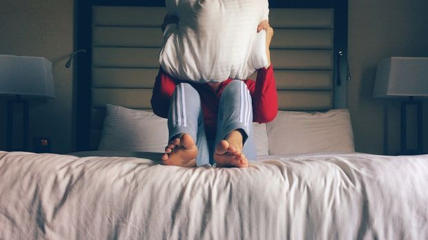 verstecken im Bett