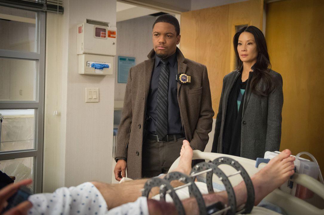 Auf der Jagd nach einem Killer: Detective Bell (Jon Michael Hill, l.) und Watson (Lucy Liu, r.) ... - Bildquelle: CBS Television