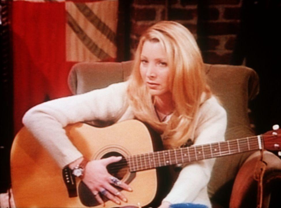Phoebe (Lisa Kudrow) hat wieder mal ein Lied komponiert. Ob sie damit Erfolg hat? - Bildquelle: TM+  2000 WARNER BROS.