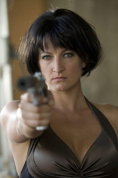 Eve (Zoe Bell) ist eine erfolgreiche, eiskalte Profikillerin. Sie stellt keine Fragen und tötet ohne Spuren zu hinterlassen. Doch eines Tages rammt... - Bildquelle: 2009 Colton Productions, Inc. All Rights Reserved.
