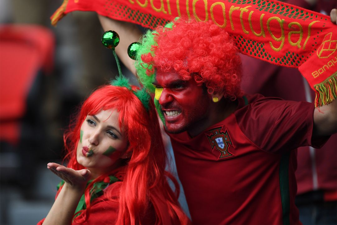 Portogues_kiss_cheering_FRANCISCO LEONG_AFP - Bildquelle: AFP / FRANCISCO LEONG