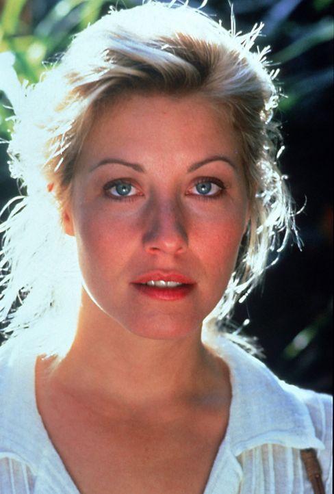Die hübsche Journalistin Sue (Linda Kozlowski) wird von kolumbianischen Drogengangstern entführt ... - Bildquelle: Paramount Pictures