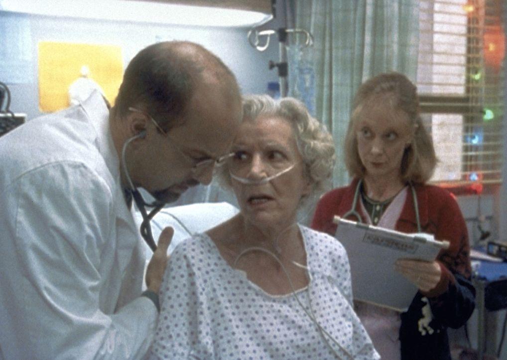 Die freundliche Ansprache von Dr. Greene (Anthony Edwards, l.) ruft bei einer Patientin Misstrauen hervor. - Bildquelle: TM+  2000 WARNER BROS.