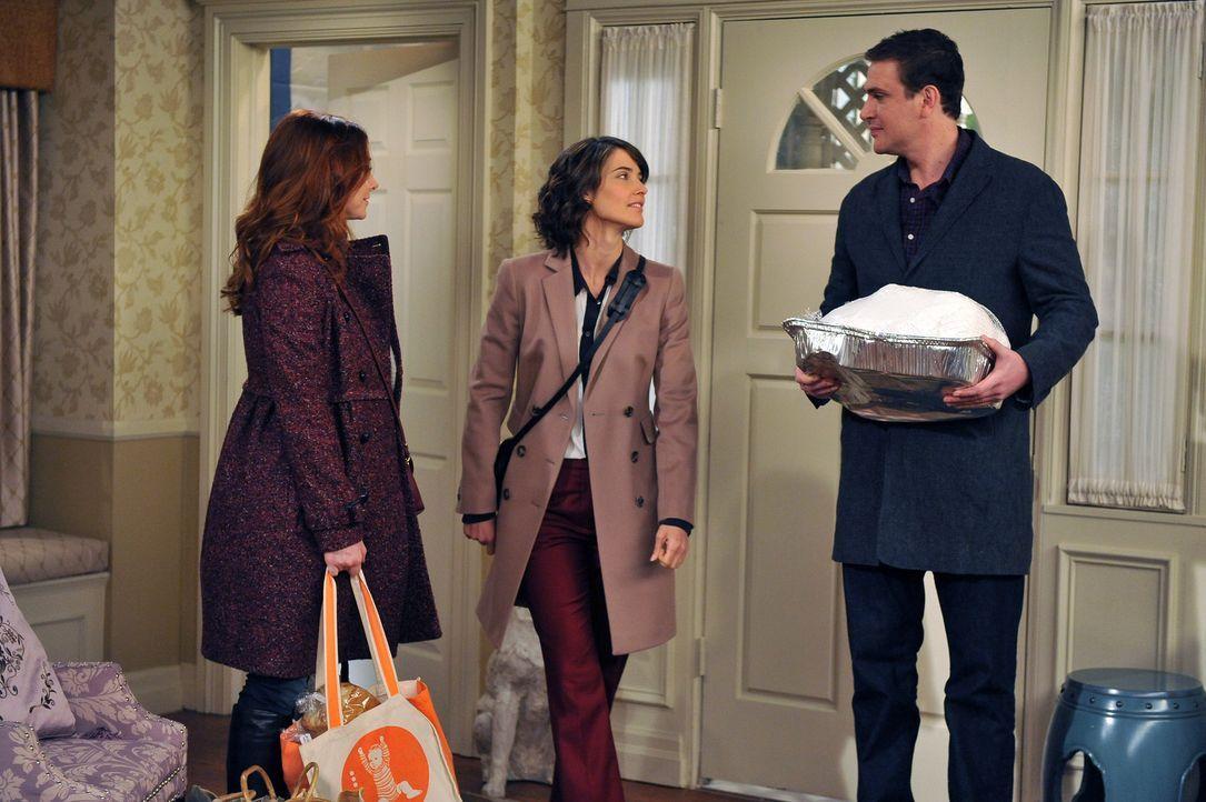 Lily (Alyson Hannigan, l.) und Marshall (Jason Segel, r.) schließen nicht aus nach Long Island umzuziehen, was Robin (Cobie Smulders, M.) mit allen... - Bildquelle: 20th Century Fox International Television