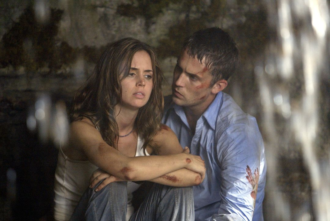 Jesse (Eliza Dushku, l.) und Chris (Desmond Harrington, r.) werden gnadenlos von einem Rudel mutierter Kreaturen gejagt, die ihre Bergarbeitertätigk... - Bildquelle: Constantin Film Produktion GmbH