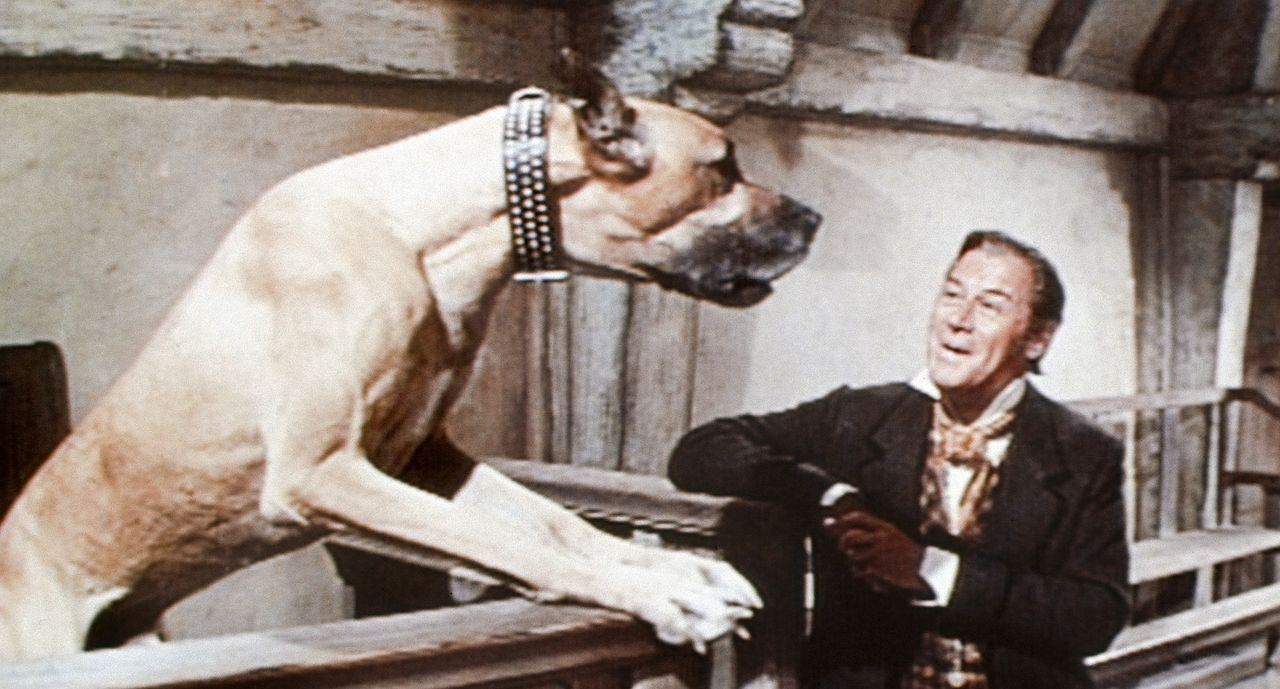 Kein Grund zur Panik - diese mannshohe Dogge will Doctor Dolittle (Rex Harrison) nur erzählen, dass sie ein Zipperlein plagt. Und Dolittle weiss natürlich Rat ...
