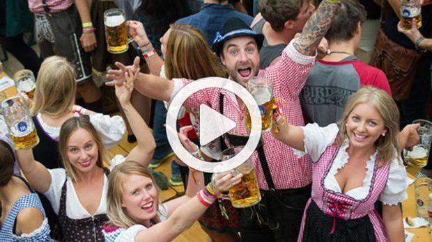 Oktoberfest-Besucher_dpa_Playbutton