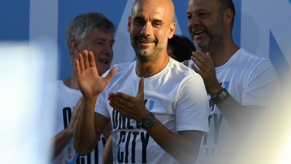 Guardiola bleibt bis 2021 bei ManCity - Bildquelle: AFPSIDPAUL ELLIS