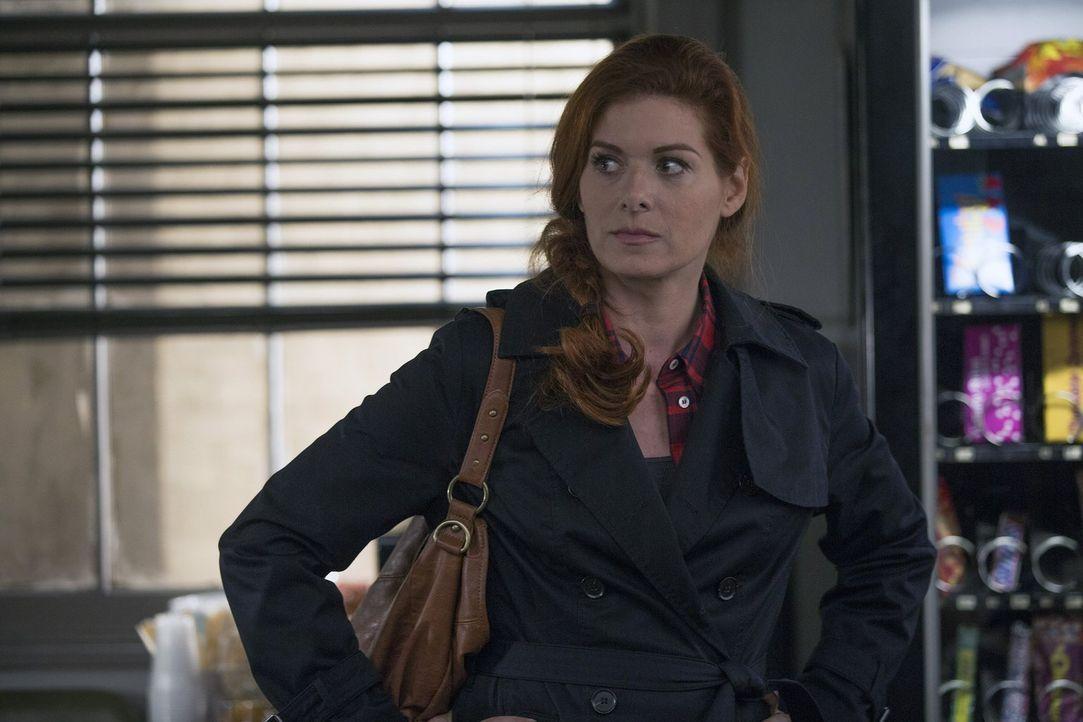 Laura Diamond (Debra Messing) ist eine taffe Polizistin, die versucht, Karriere und ihre Familie unter einen Hut zu bringen ... - Bildquelle: Warner Bros. Entertainment, Inc.