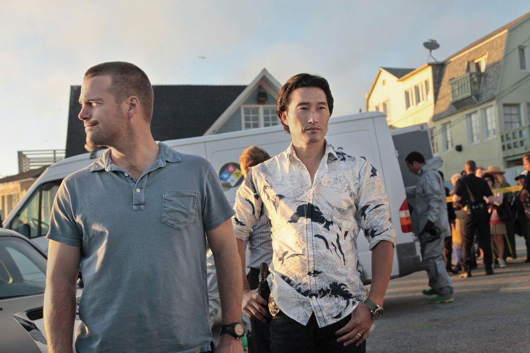 Können Callen (Chris O'Donnell, l.), Chin (Daniel Dae Kim, r.) und ihre Kollegen den Fall lösen, an dem sie gemeinsam ermitteln? - Bildquelle: CBS Studios Inc. All Rights Reserved.
