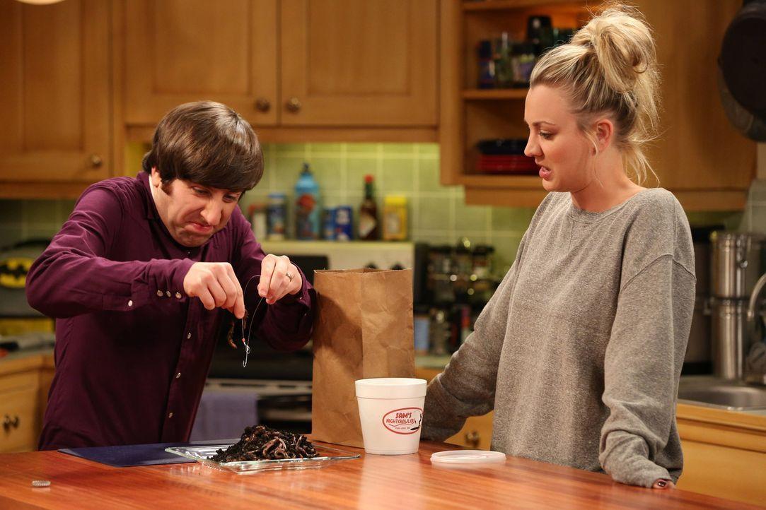 Penny (Kaley Cuoco, r.) bereitet Howard (Simon Helberg, l.) auf seinen Angelausflug mit seinem Schwiegervater vor ... - Bildquelle: Warner Bros. Television