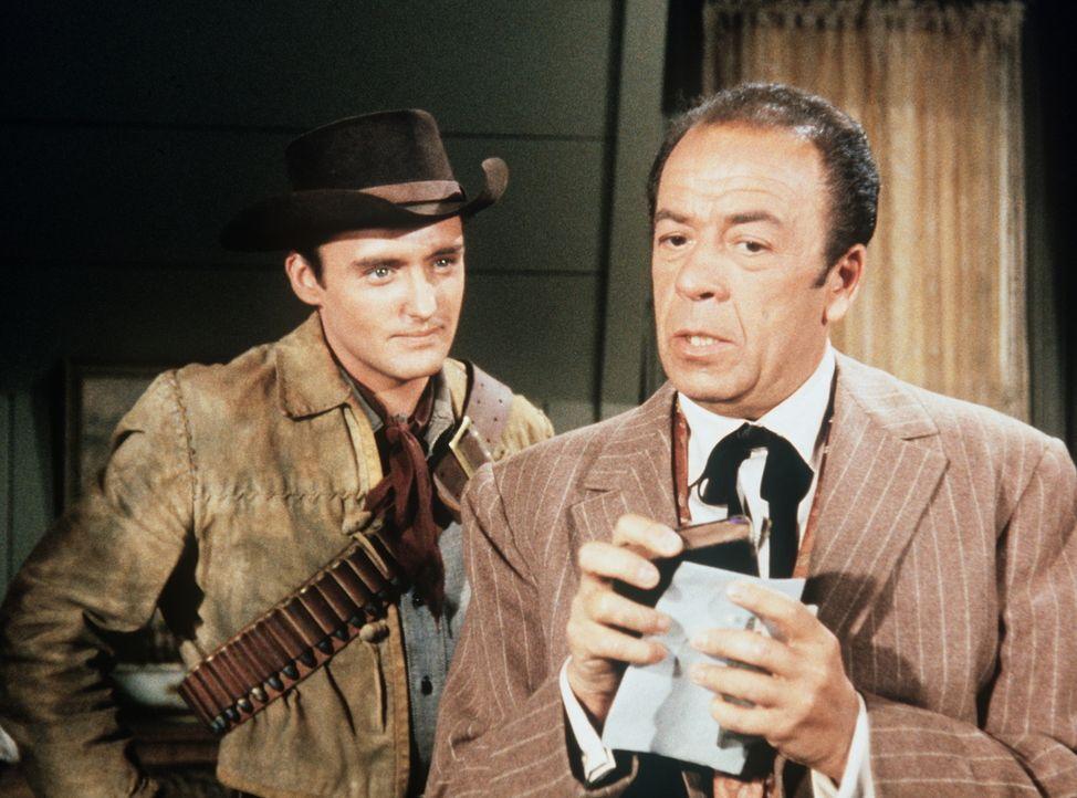 Schlitzohr Wetzell (Lewis Charles, r.) muss erkennen, dass Dev Farnum (Dennis Hopper, l.) einen genialen Plan hat, der ihm 1000 Dollar einbringen kö... - Bildquelle: Paramount Pictures
