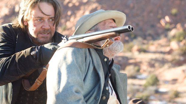 Als der berüchtigte Bandit und Outlaw Ben Wade (Russell Crowe, l.) mit seinen...