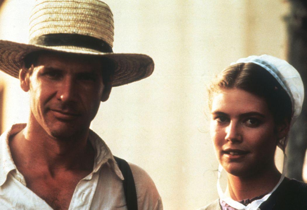 Bei der Aufklärung eines Mordes kommen sich der Cop John Book (Harrison Ford, l.) und Rachel (Kelly McGillis, r.), die Mutter des einzigen Zeugen,... - Bildquelle: Paramount Pictures