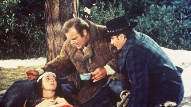 Hoss (Dan Blocker, M.) und Little Joe Cartwright (Michael Landon, r.) sind in...