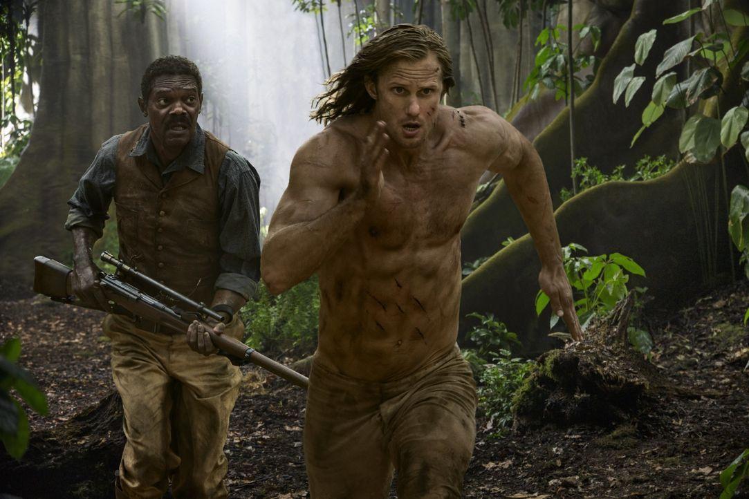 (v.l.n.r.) George Washington Williams (Samuel L. Jackson); Tarzan (Alexander Skarsgård) - Bildquelle: Warner Bros.