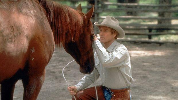 Der wortkarge Aussteiger Tom Booker (Robert Redford) hat die außergewöhnliche...