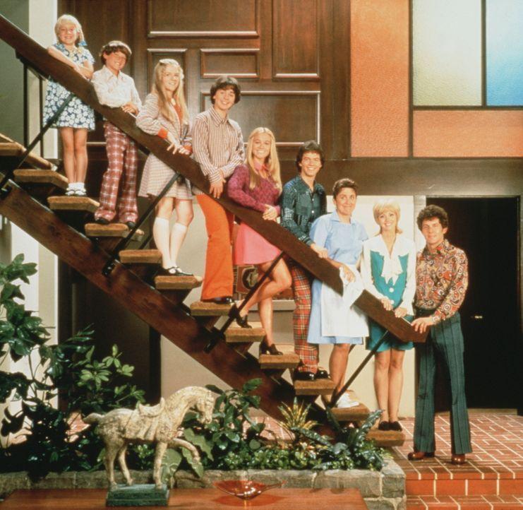 Die Zeit ist für sie stehen geblieben - ganz im Stil der 70er Jahre tragen sie Hosen mit Schlag, pastellfarbene Hemden mit spitzen Krägen, Schuhe mi...