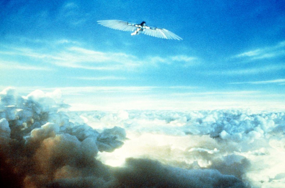 In seinen Träumen wachsen dem kleinen Beamten Sam (Jonathan Pryce) Flügel: Als strahlender Held schwingt er sich auf, für das Gute zu kämpfen. - Bildquelle: 20th Century Fox of Germany