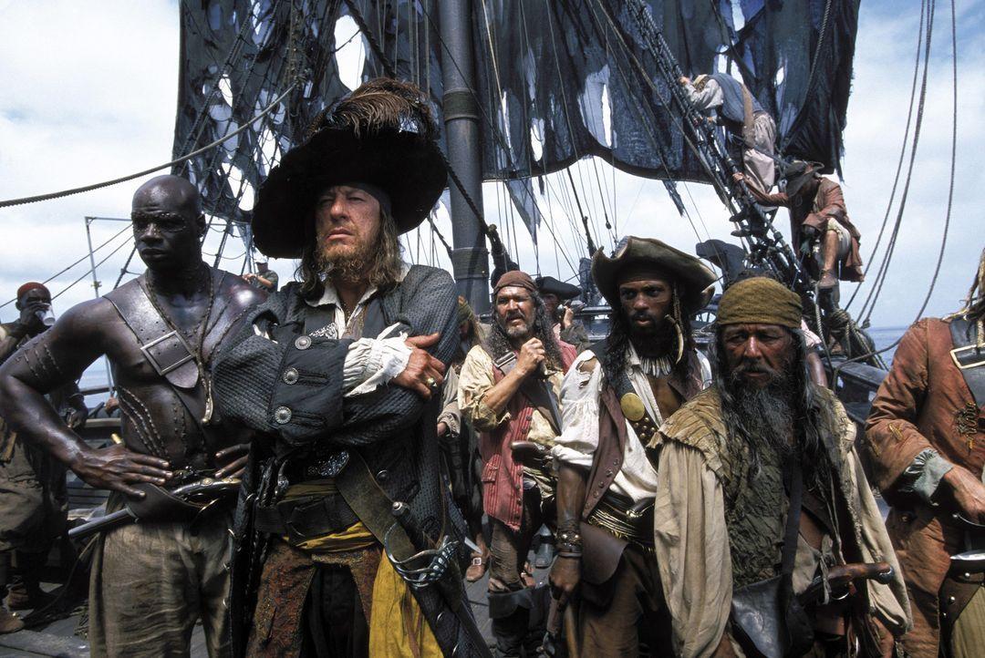Auf der Mannschaft und seinem Captain (Geoffrey Rush, M.) liegt ein grausamer Fluch: Der Raub eines verfluchten Azteken-Schatzes zwingt sie, als Unt... - Bildquelle: Disney/ Jerry Bruckheimer