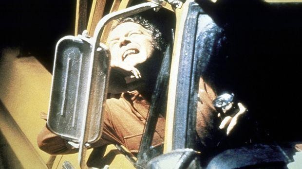 Roy Neary (Richard Dreyfuss) wird von einem Ufo geblendet ... © Columbia Pict...