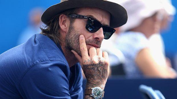 David Beckham mit Sonnenbrille und Hut
