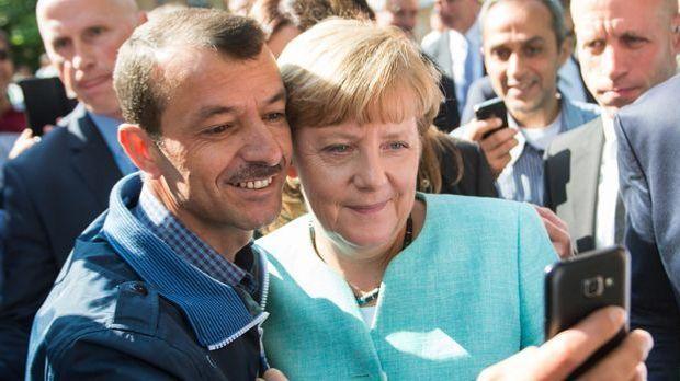 Neujahr_2015_12_18_Neujahrsansprache Angela Merkel_Bild 1_dpa