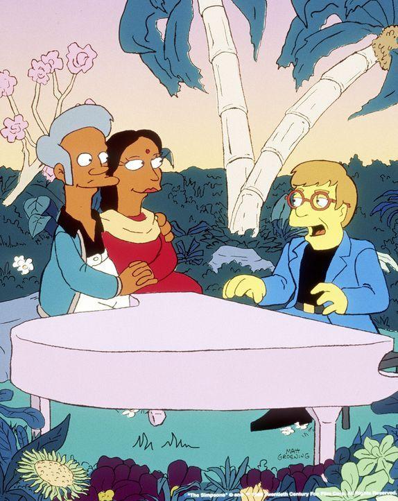 Zum Valentinstag hat Apu (l.) für Manjula (M.) Elton John (r.) eingeladen. - Bildquelle: und TM Twenthieth Century Fox Film Corporation - Alle Rechte vorbehalten