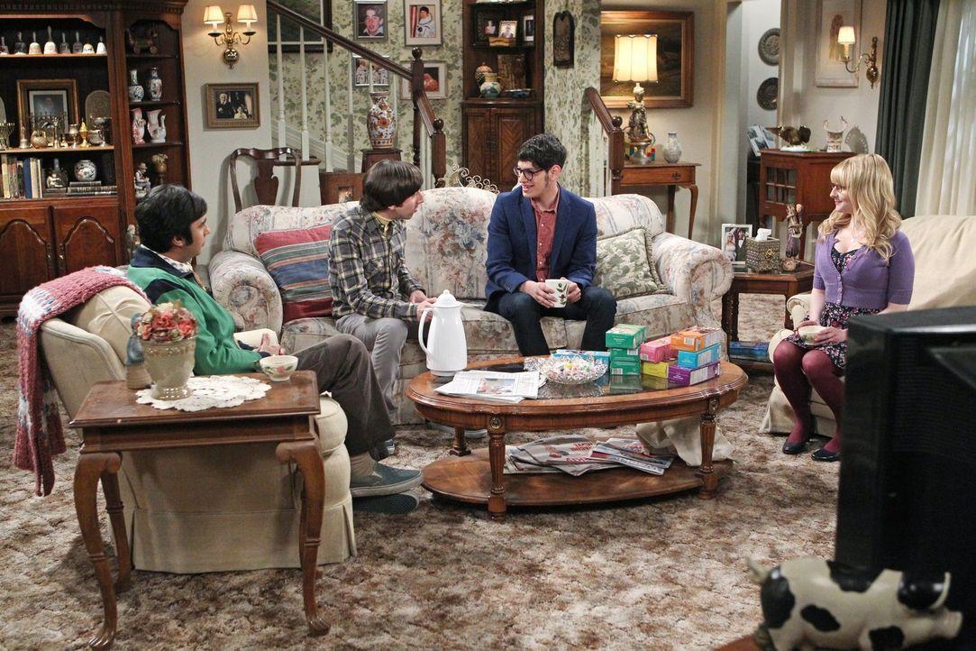 Trotz aller Erklärungsversuche können Howard (Simon Helberg, 2.v. l.), Bernadette (Melissa Rauch, r.) und Raj (Kunal Nayyar, l.) einfach nicht glaub... - Bildquelle: Warner Bros. Television