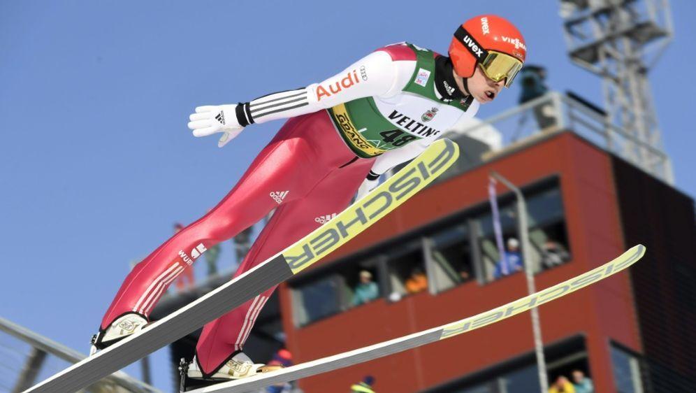 Nach dem Springen auf Position vier: Eric Frenzel - Bildquelle: LehtikuvaLehtikuvaAFPMarkku Ulander