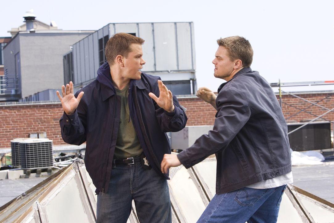 Ein mörderisches Katz- und Mausspiel um echte Verräter und falsche Freunde beginnt: Colin Sullivan (Matt Damon, l.) und Billy Costigan (Leonardo DiC... - Bildquelle: Warner Bros. Entertainment Inc