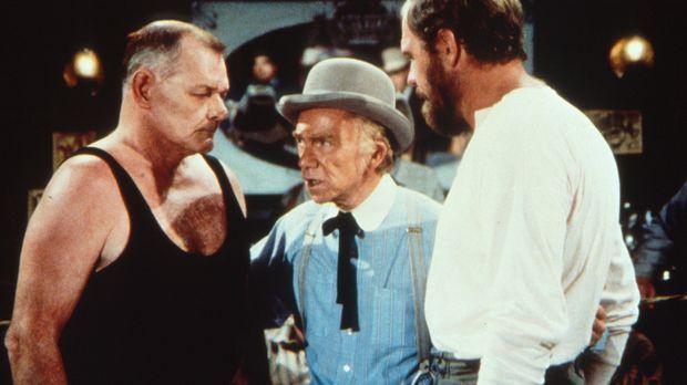 Garvey (Merlin Olsen, r.) muss gegen Milos Stavronpolis (Leo Gordon, l.) den...